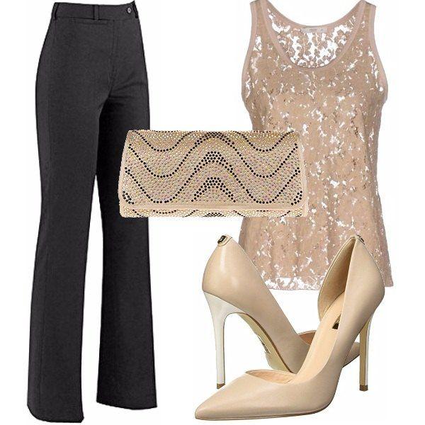 a898ef5f5318 Un look semplice e chic adatto a cerimonie e serate eleganti composto da  pantalone nero leggermente