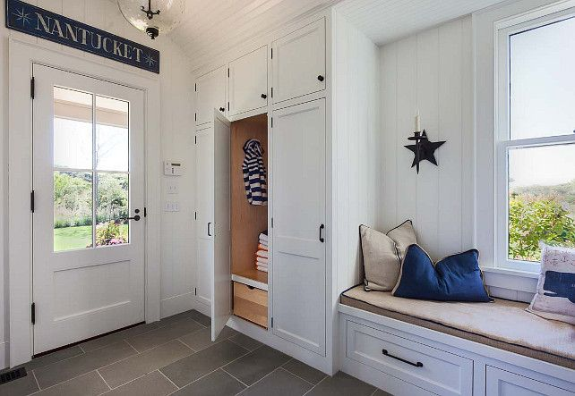 Cottage Mudroom Features A Built In Window Seat Lined With A Whale Pillow  As Well As Blue And Beige Pillows Next To Closed Mudroom Lockers Fitted  With A ...