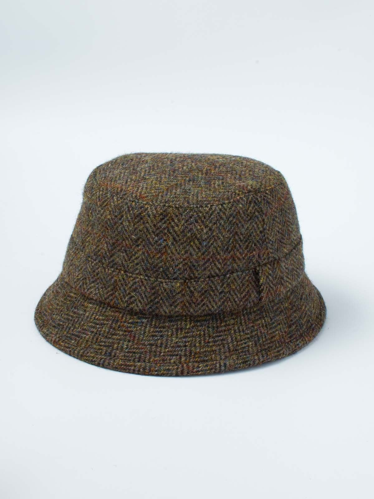 Harris Tweed Roll-Up Hat - Originally designed as a fly fisherman's hat this famous Tweed hat is now quite at home in the town. Made to last, this rugged fabric captures the heather and hues of a Scottish moor. Its luxurious quilt lining will keep you snug and comfortable when the wind gets up. Its canny construction means you can roll it up and pop it in your pocket yet it won't lose its shape. So whether your casting for trout or fishing for compliments this is the hat to bring you luck...