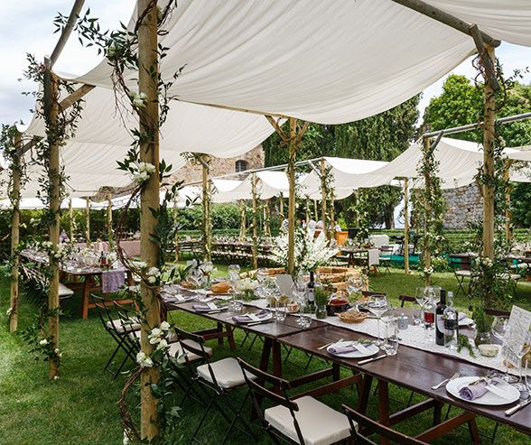 Outdoor Wedding Seating Ideas: White Fabric Is Loosely Draped Over Natural Wooden Beams