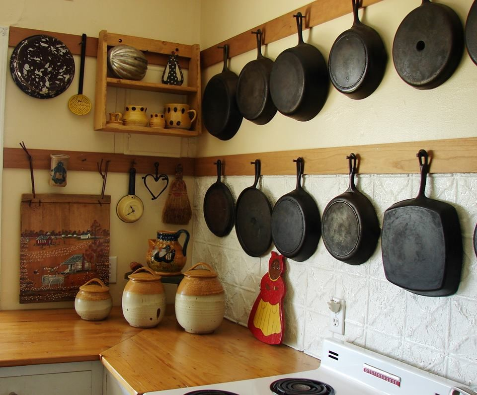Pic of a way to display cast iron pans on a wall found via for Kitchen display wall