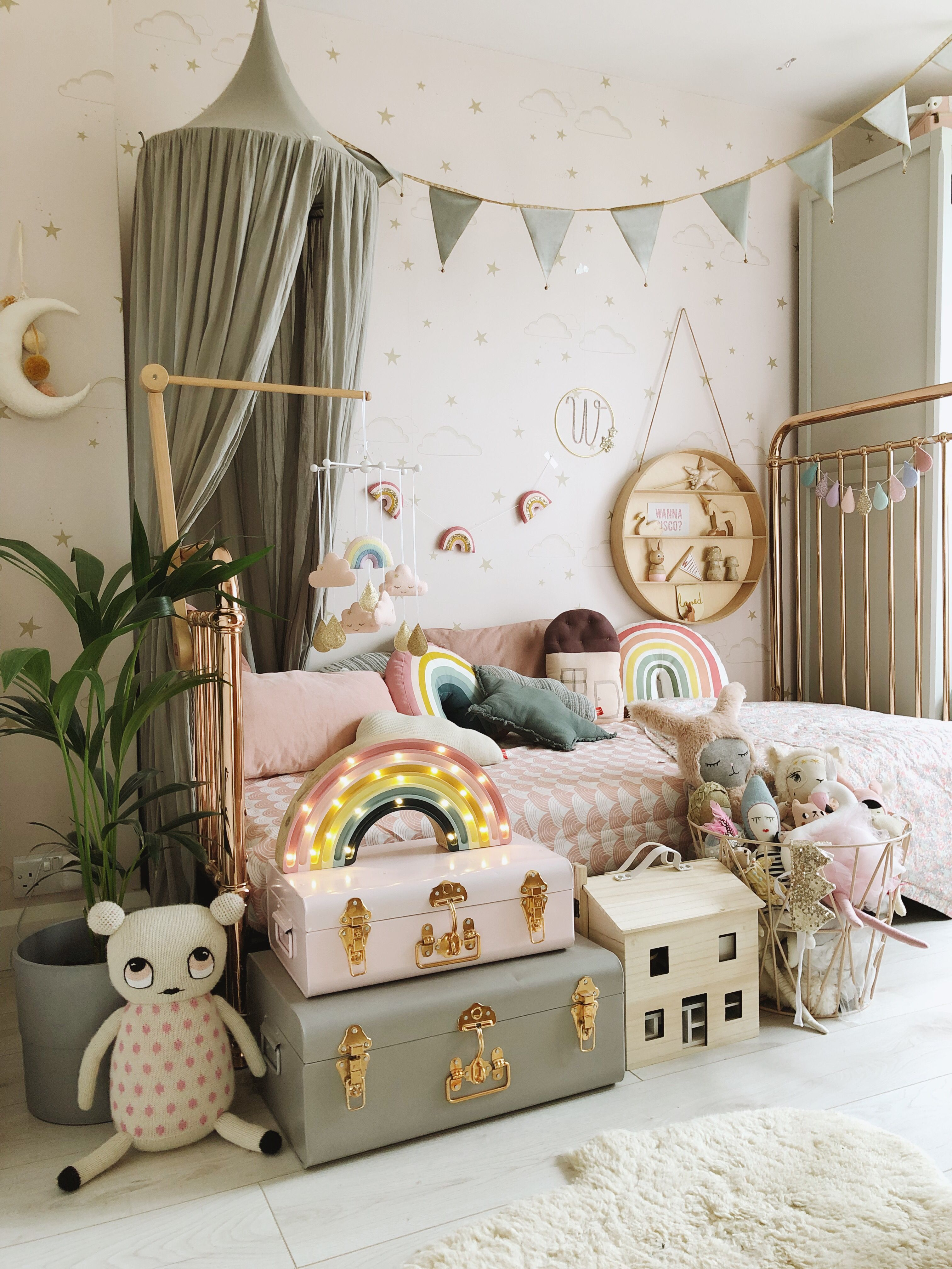 A dreamy girls bedroom with soft grey bed canopy and bunting by Numero74, rainbow bed sheet by Swedish Linens, rainbow light by Little Lights, and garlands and mobiles by Velveteen Babies  Styled by V is part of Dreamy girls bedroom -