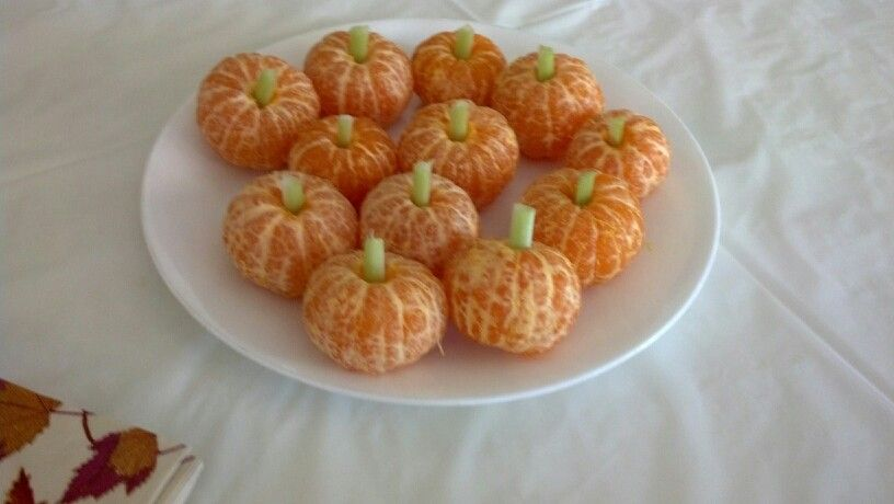 Cute little pumpkins made out of Mandarin oranges.  Just peal and add a little piece of celery
