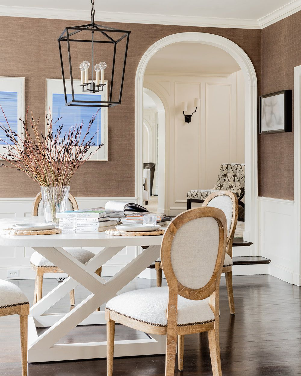 Gorgeous grass cloth covered dining room by hudson interior designs