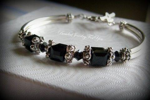 @ 6mm jet black Swarovski crystal cubes, 4mm jet black bicones, antiqued pewter star shaped bead caps and spacers,  Black Crystal Bracelet