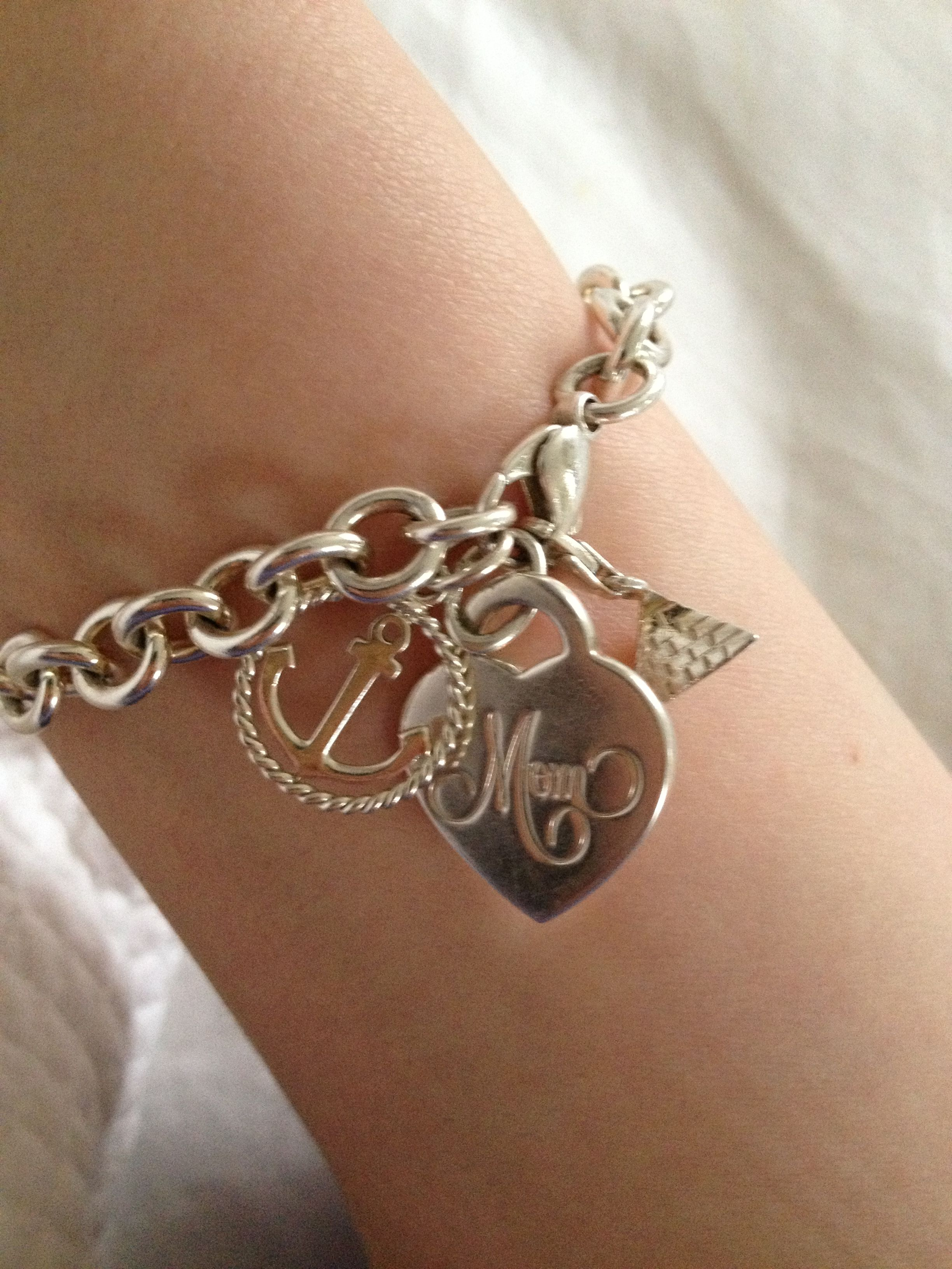 Tiffany s Mom Charm bracelet I would add 2 heart charms with Nick