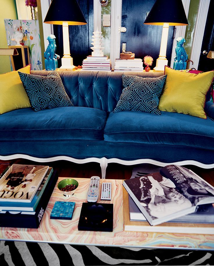 The vintage 1950s French sofa, reupholstered in candy-blue velvet