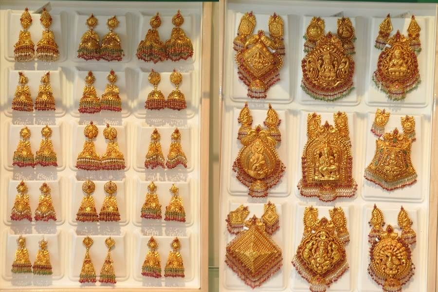 Kazana Jewellery latest antique jhumkas and locket pendant collections