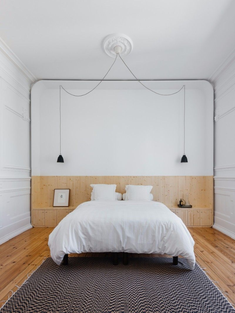 Minimalistic bedroom design with a surreal rug