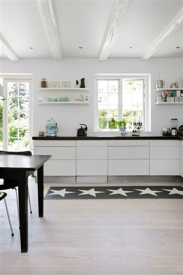 Nice Elegant White Kitchen With Black Countertop, Corner Layout By The Window.