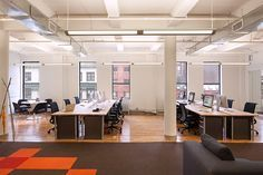 wood floor, removable and replaceable office tiles, accent colors (like orange)