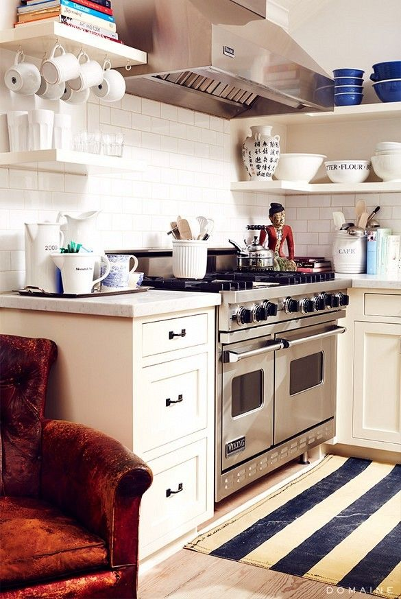Open shelves in the kitchen and white kitchen accessories.