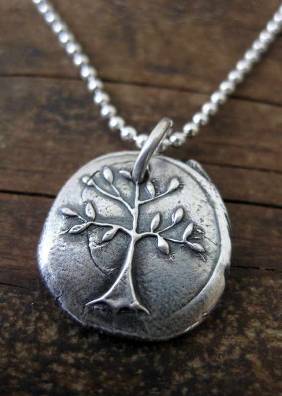 Silver Tree Pendant Symbol Of Strength And Courage Tattoo Ideas