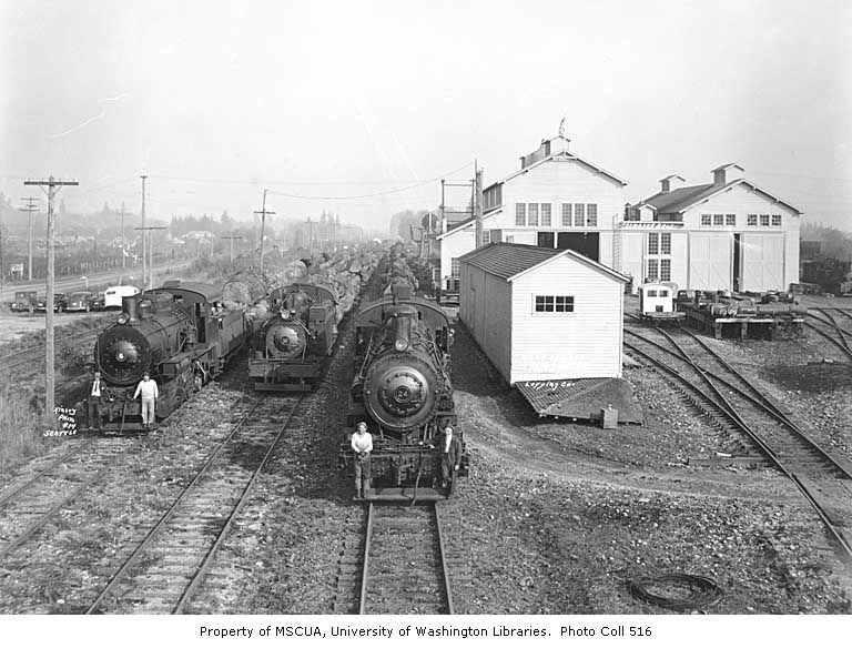 Schafer Brothers Logging Company headquarters at Satsop, showing shops and locomotive nos. 6, 10, and 24 with log trains and crew
