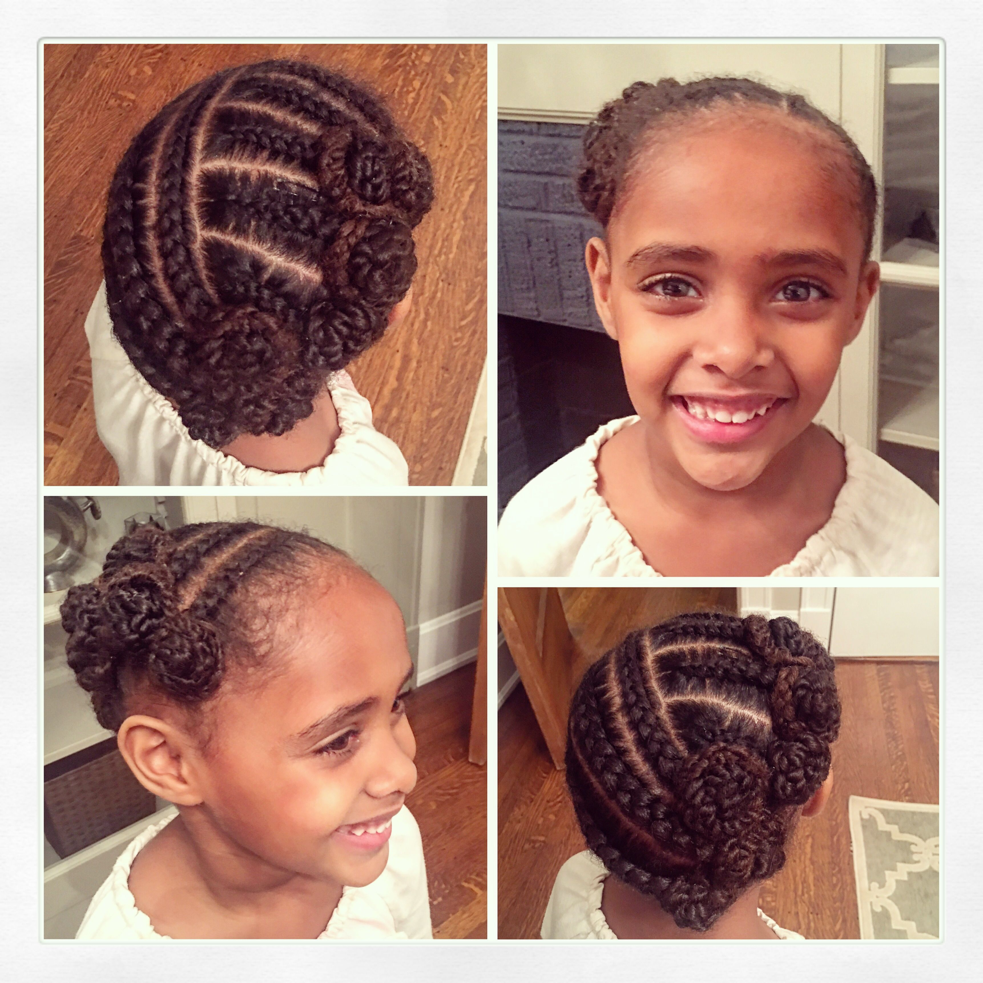 Little Girl Braids Twisted Into Rosettes Cornrows African