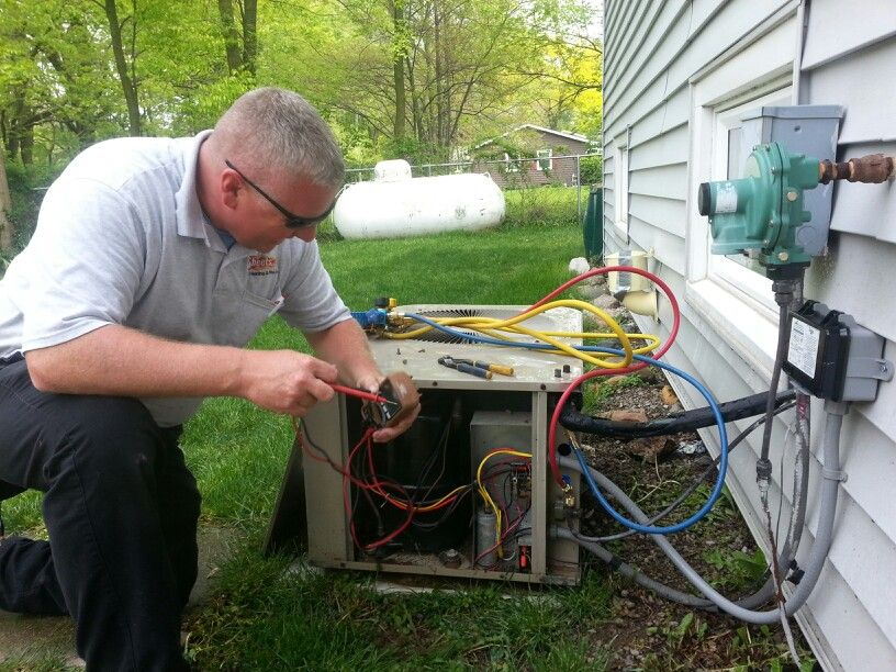 Dwayne getting ready to check the voltage on our AC unit