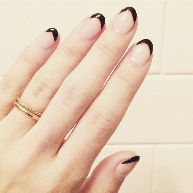 Short pointy nails with a black french. Description from ...