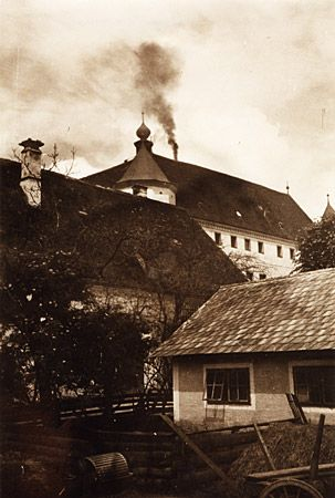 """Smoke rising from the chimney of the crematorium. Operation T-4 targeted mostly adult patients. By the end of World War II, an estimated 200,000 adults were murdered in various """"euthanasia"""" programs. Verein Scholoss Hartheim, Alkoven, Austria. Photo by Wolfgang Schuhmann; Diakonie-Kork Epilepsiezentrum, Kehl-Kork, Germany. From """"Deadly Medicine: Creating the Master Race."""" USHMM."""