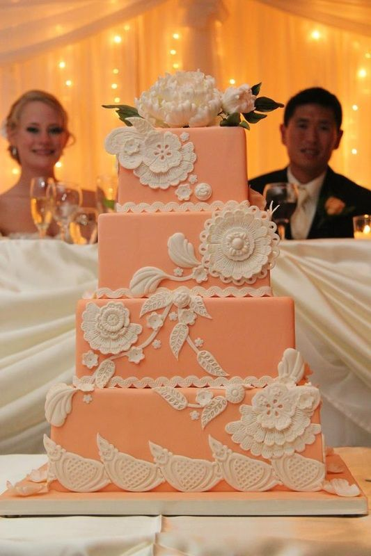 Very pretty light coral wedding cake with whit detail.  Lovely!  ᘡղbᘠ