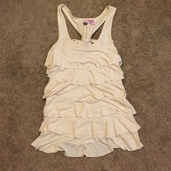 Nordstrom Cream/beige Tank This is a cream ish colored Ruffled tank top from Nordstroms.   Never worn, but doesn't have tags.   It has tiers of Ruffles and the back has a tie.  Size medium. love on a hanger Tops Tank Tops