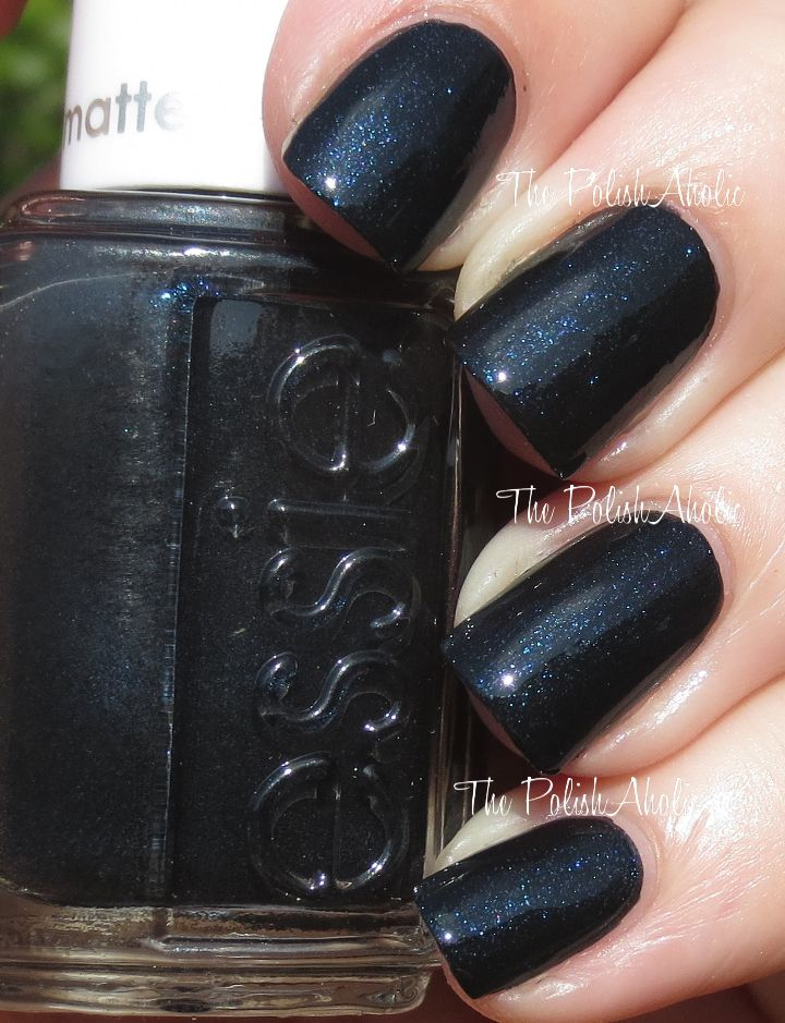 Spun In Luxe is a black base with blue shimmer with a shinny top ...