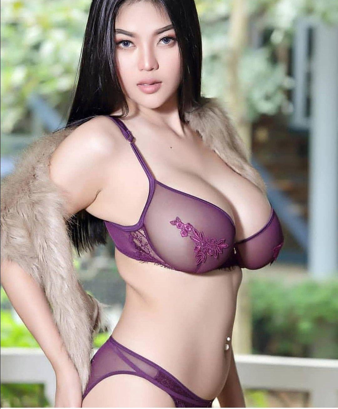 Sexy asian woman wearing black bra stock photo