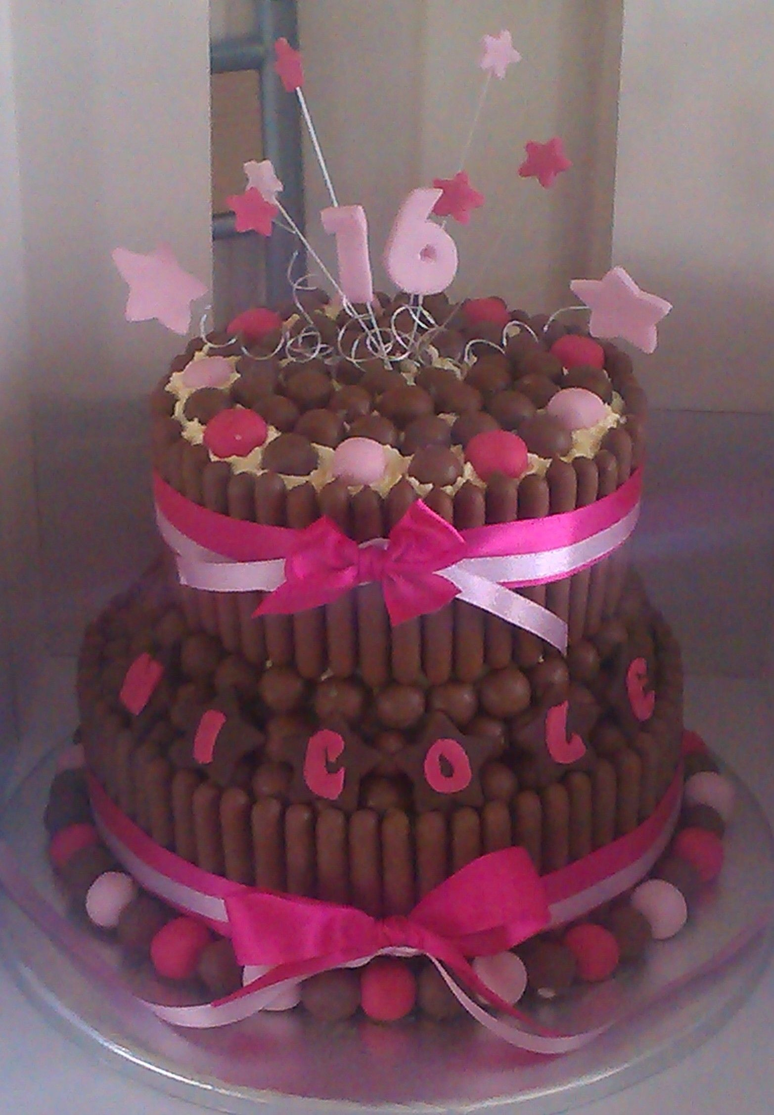 Double Tier, 16th Birthday Cake (for nicole) Choc-chip sponge filled and topped with white chocolate butter cream, with choc fingers & Maltesars. x