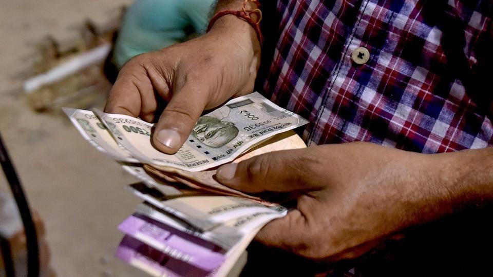 Rupee down 21 paise against dollartrade war worries among