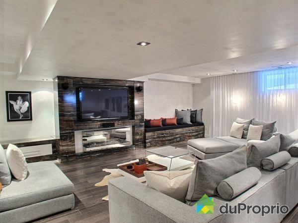 id es pour un salon dans le sous sol magnifique salon contemporain avec des touches rustiques. Black Bedroom Furniture Sets. Home Design Ideas