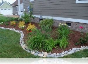 Simple rock garden ideas with white river stone border for Cheap and easy flower bed borders