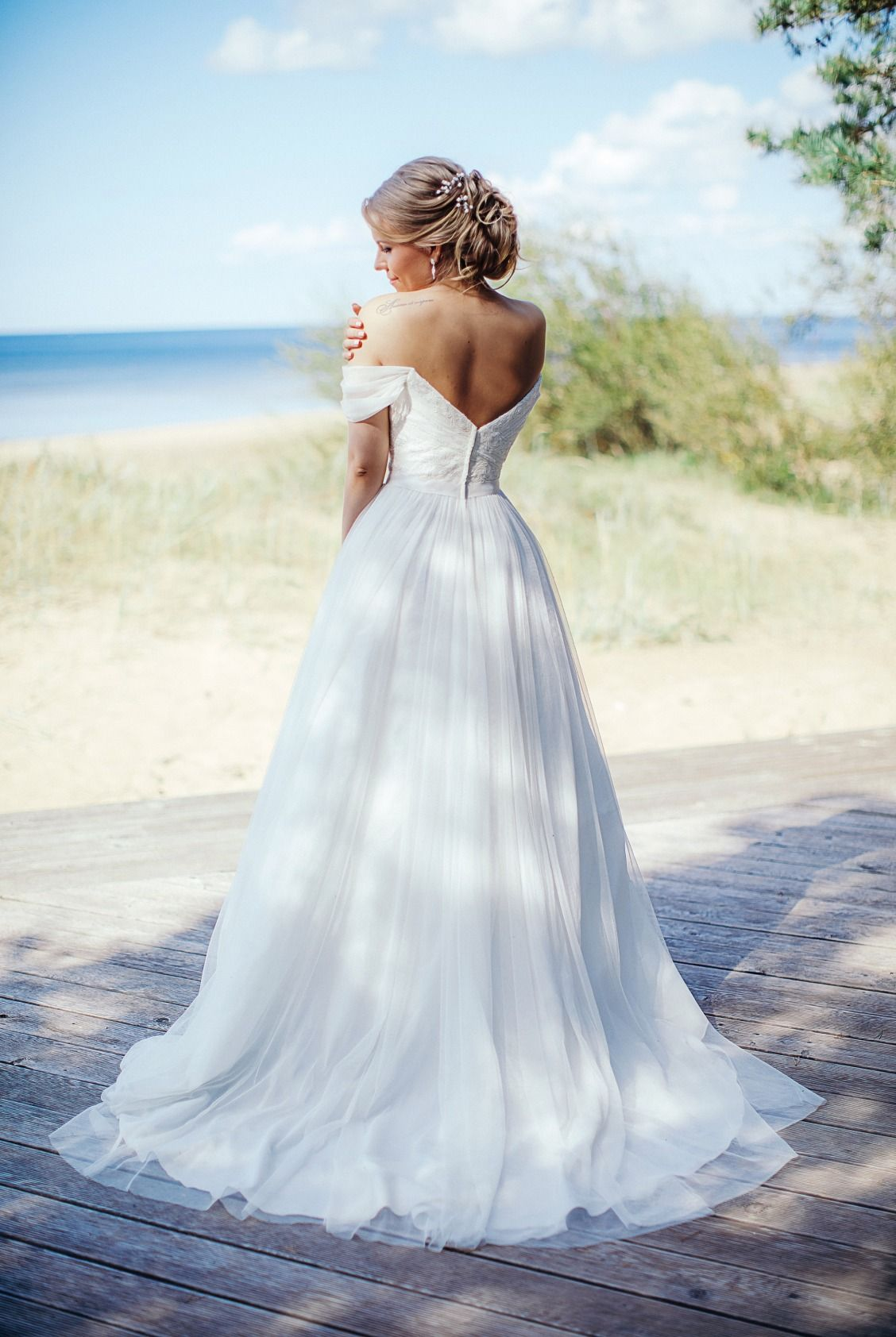 A ball gown is an unexpected choice for a beach wedding dress...but ...