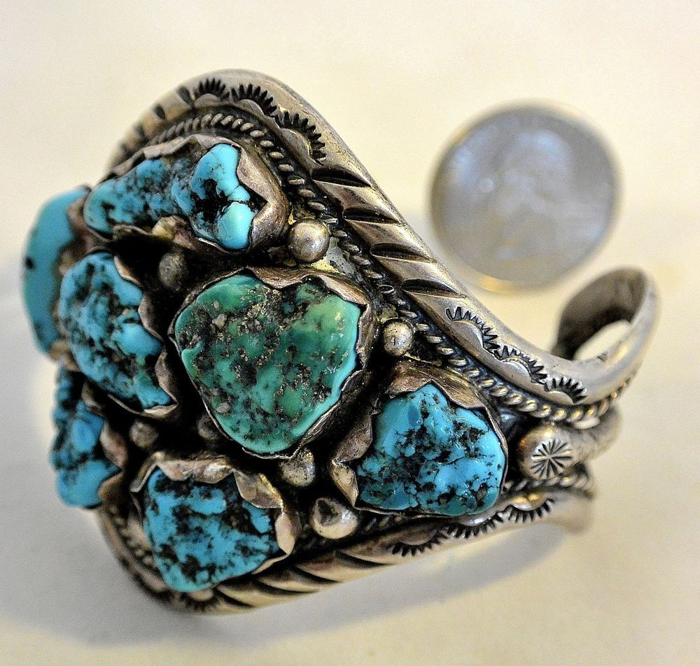 This Bracelet was made by a master Zuni Silversmith! It is attributable to Dan Simplicio due to its age, distinctive style, and the artistry of design and construction.It seems that most of the jewelry made by Dan Simplicio was not signed.   eBay!