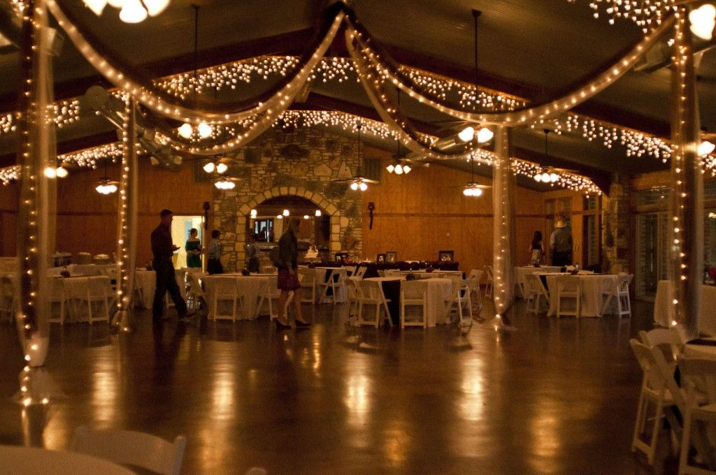 White Christmas lights hung from the ceiling beams and wrapped