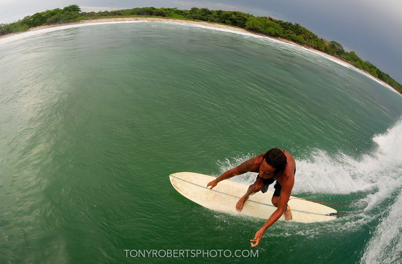 Gustavo Santana gettin' his glide on! #puravida #travel #adventure #costarica #exploremore #surflife #livetosurf #tubetime #liveinthesun #beachlife #ocean #adventuretravel #surfing #familyvacation #traveloften