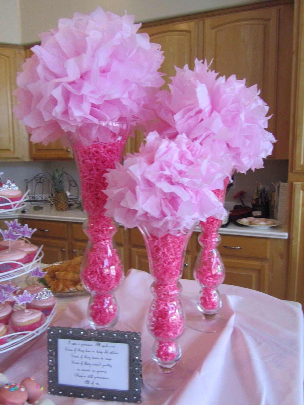 Pink baby shower centerpiece tall vases filler paper