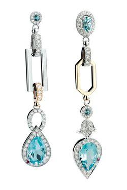 Damiani earrings....love the asymmetrical aspect!