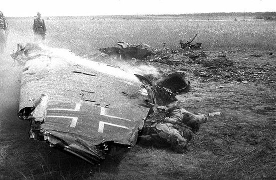 Shortly after a German plane was shot down somewhere in the region of Kaluga, Russian soldiers approach the smoking wreckage and find the bodies of two Luftwaffe flyers (July 1943)