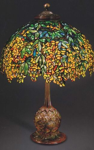 The first Tiffany lamp was created around 1895. Beautiful in design and intricacy, each lamp was handmade by skilled craftsman, not mass or machine produced. Its designer was not, as had been thought for over 100 years, Louis Comfort Tiffany, but an unrecognized single woman named Clara Driscoll who was identified in 2007 by Rutgers professor Martin Eidelberg as being the master designer behind the most creative and valuable leaded glass lamps.