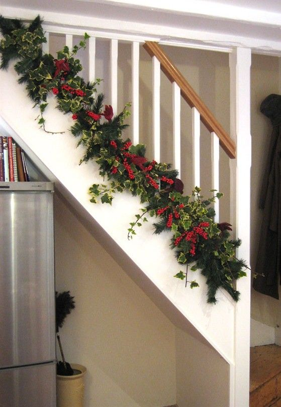 The bottom of christmas banister decorating ideas view for Christmas decorations stair rail