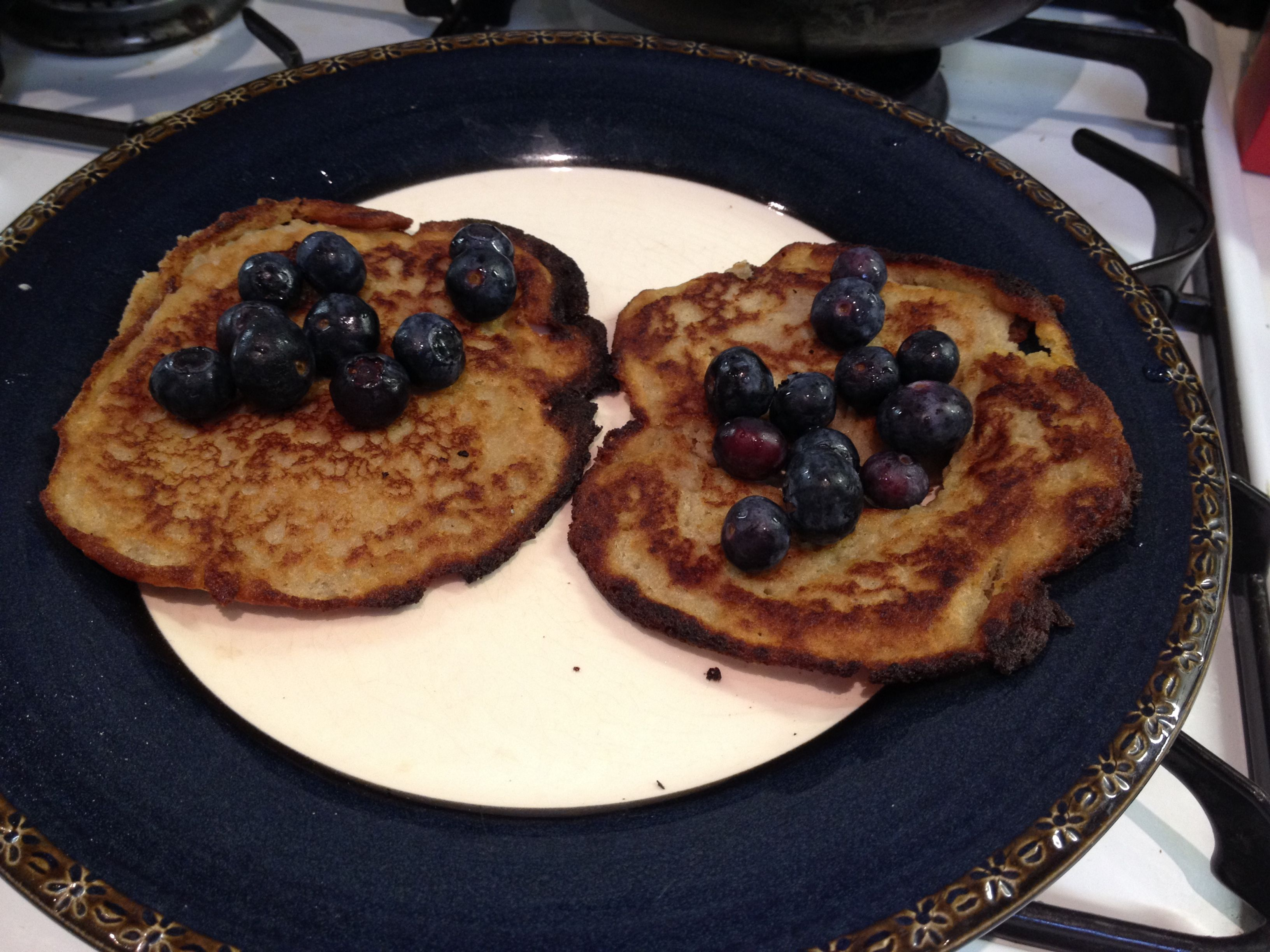Buckwheat and apple pancakes with cinnamon and blueberries.