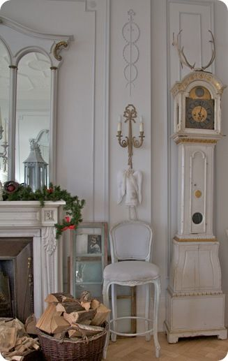 gustavian mora clock and mantlepiece