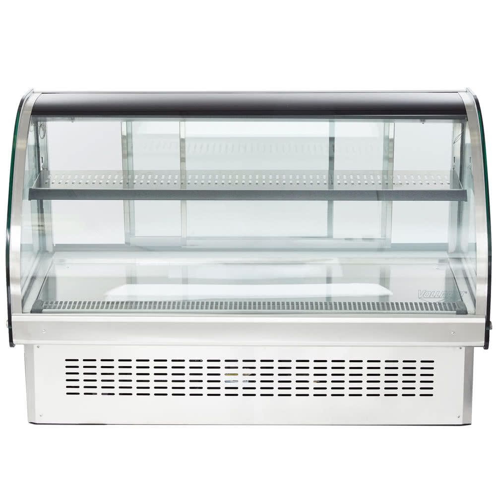 """This Vollrath 40843 48"""" curved glass refrigerated display cabinet features an attractive base that allows the unit to be installed into a counter as a drop in that blends seamlessly into your establishment, <i>or</i> as a countertop unit for optimum flexibility and space-saving efficiency! Perfect for whipped cakes, pies, creamy pastries and other chilled treats, it boasts a digitally controlled thermostat that provides precise, consistent performance at temperatures ran..."""