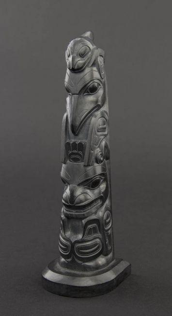 Robert davidson a carved argillite totem pole depicting