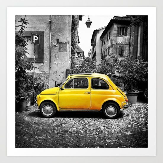 Cute yellow Fiat 500 parked in a street in Orvieto Italy/