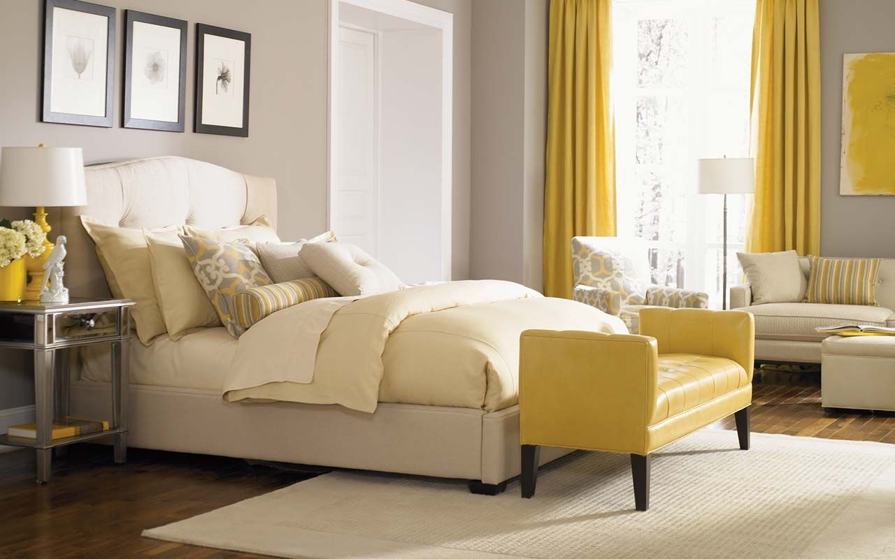 LOVE the tufted headboard and yellow accents