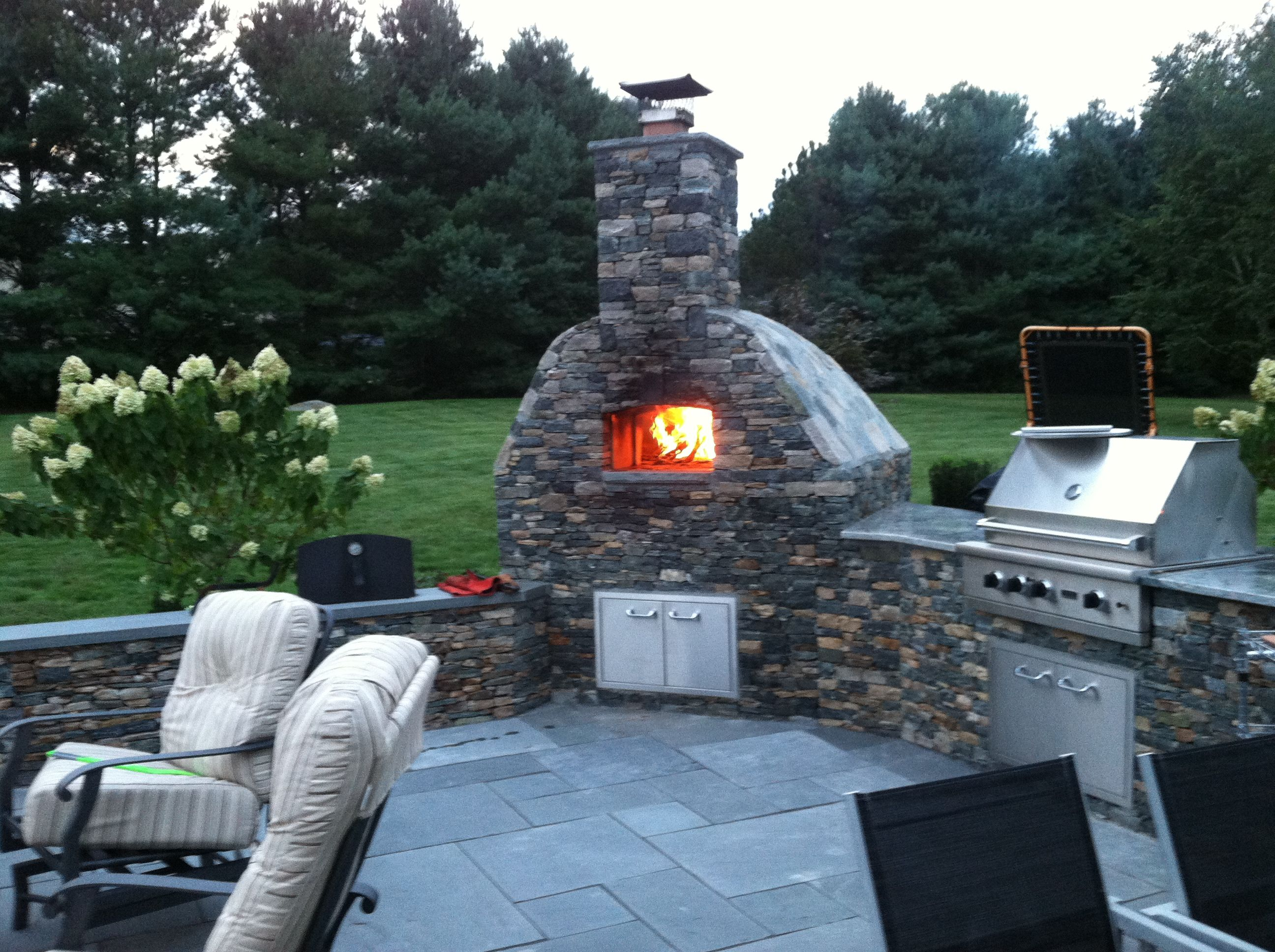 outdoor kitchen with wood fired oven and grill wood fired pizza