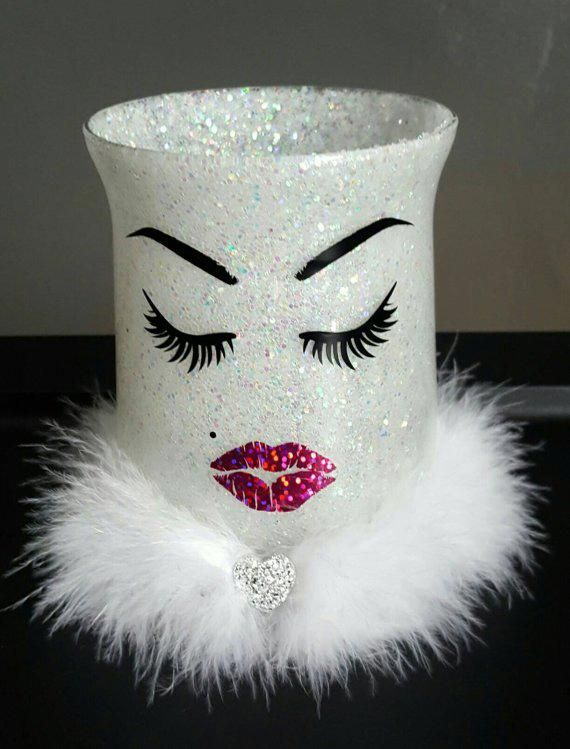 Photo of White glitter makeup holder. Brushes. Lashes & lips. Pink lipstick kiss. Vanity decor.