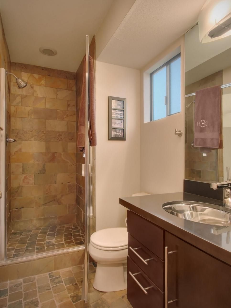 Small Bathroom Features Earth Tone Tile In 2019