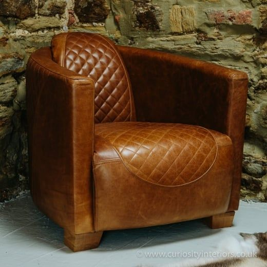 brown leather tub chair with footstool dental office waiting room chairs buy quilted vinatge italian armchair furniture