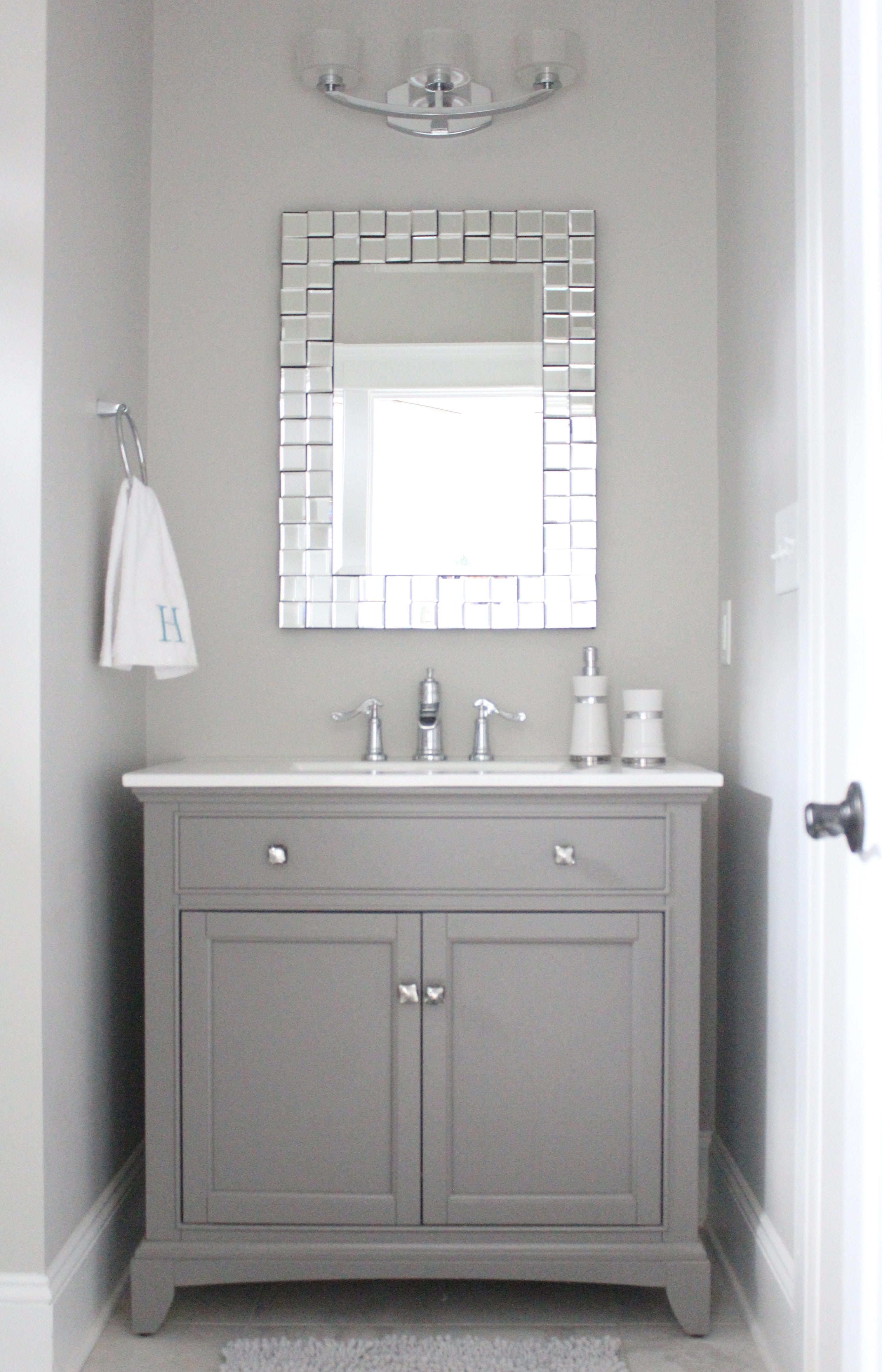 Grey and white bathroom with mirror Paint color Repose Gray by